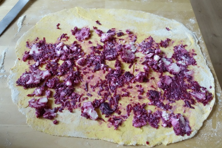 Beetroot and cheese on dough